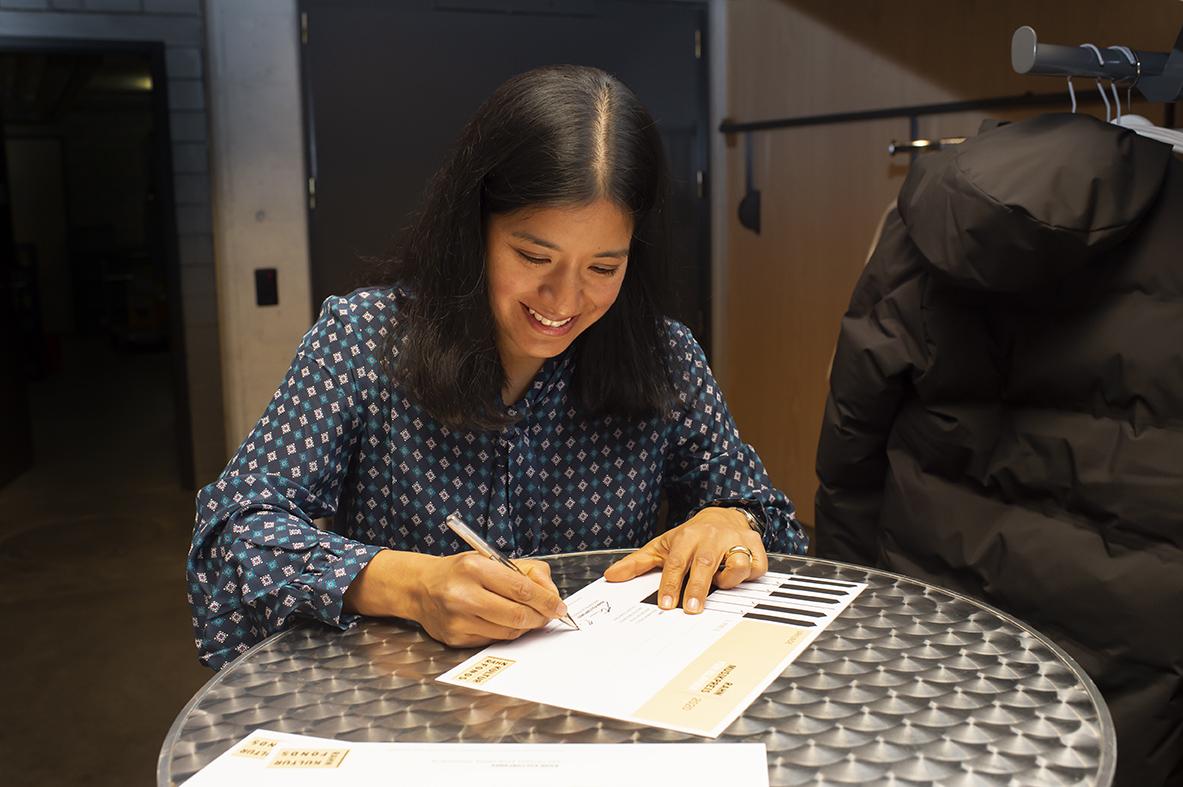 Ana P. Rahn Erden signs the certificates